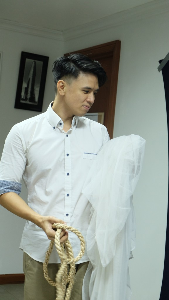 Photography Workshop instructor, Mr. Mike Alegado, preparing props for his demo photo shoot.